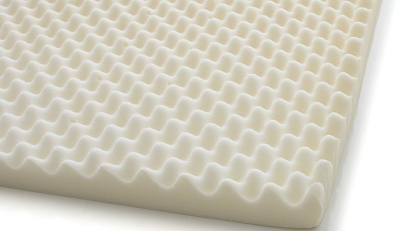 A white hospital eggcrate memory foam topper