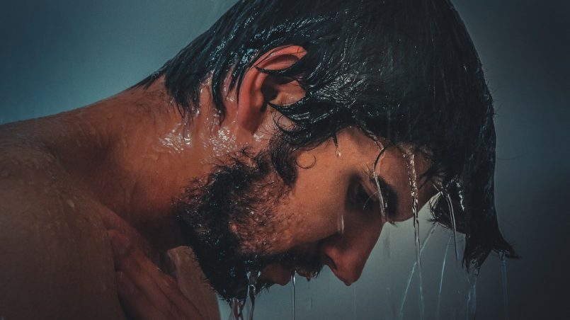A man taking a cold shower