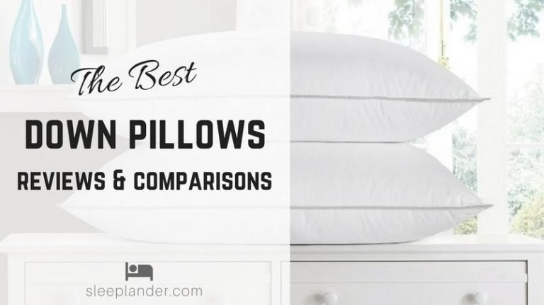 A pair of luxury down pillows on a nightstand