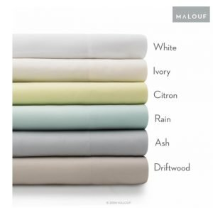 Silky and soft bamboo sheets in many different colors arranged neatly on the bed