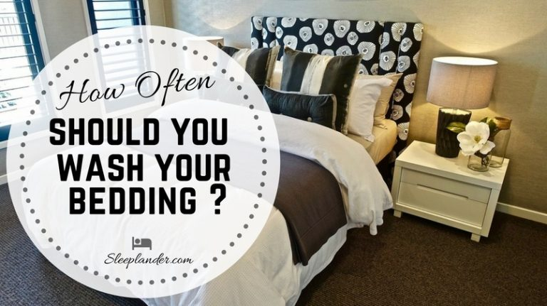 A clean and crisp bed, with washed bed sheets, comforter, pillows and pillowcases.