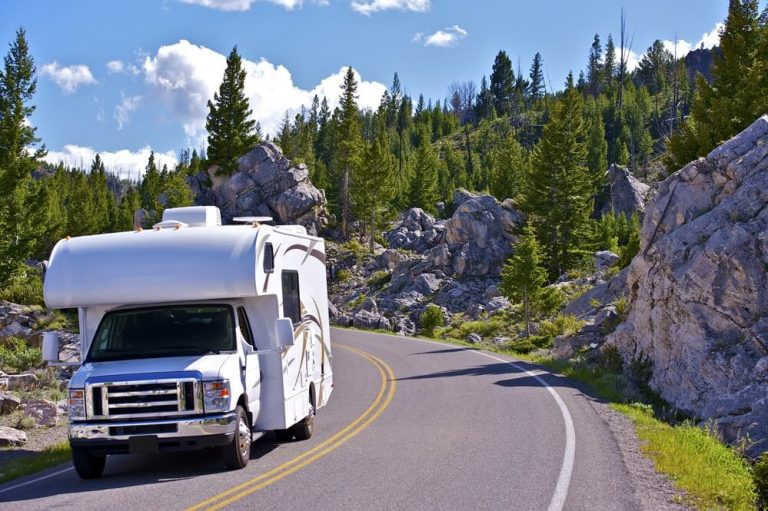 An Americana RV travelling through the mountains at high altitude