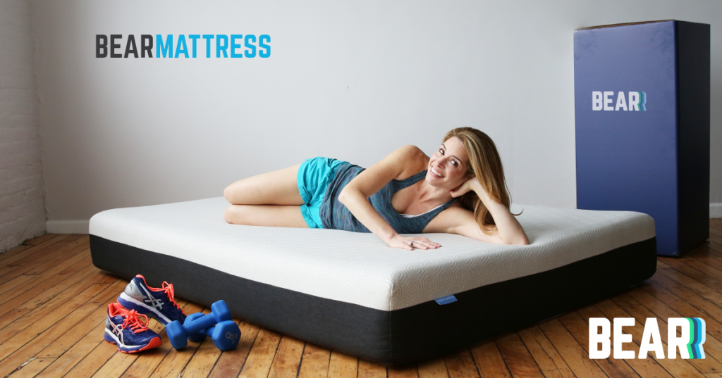 A female athlete resting on a Bear Mattress