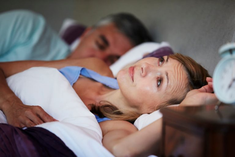 Female osteoarthritis sufferer difficulty sleeping