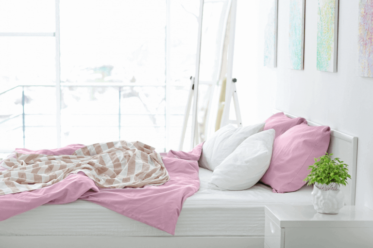 A modern light bedroom, pink and white tencel lyocell bed linen, white headboard