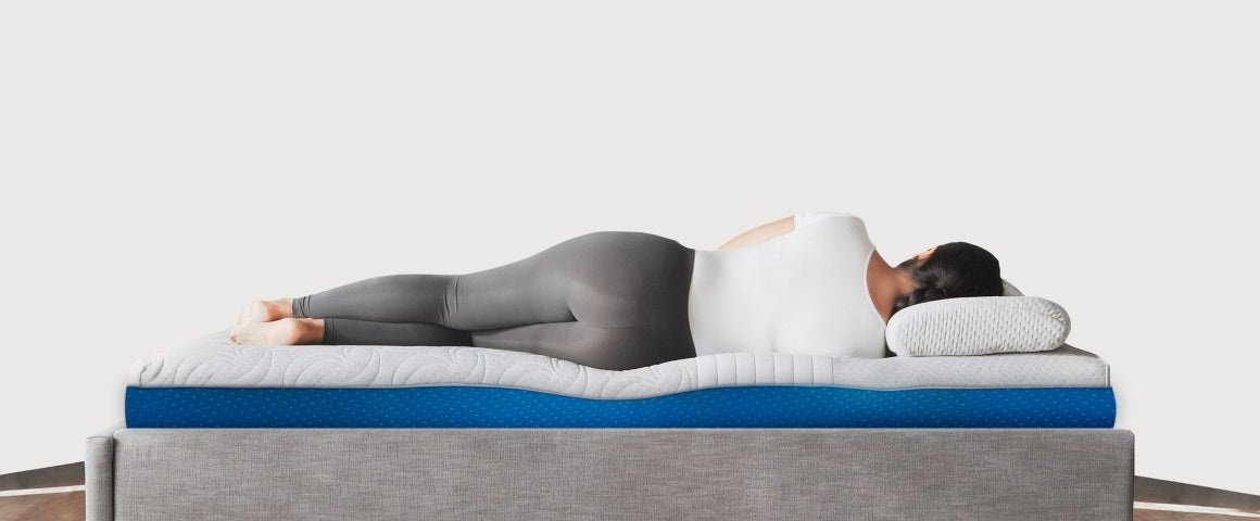 Woman sleeping on side showing pressure points on hips and shoulders