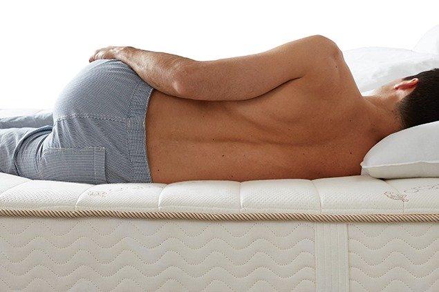 Man sleeping on a supportive mattress