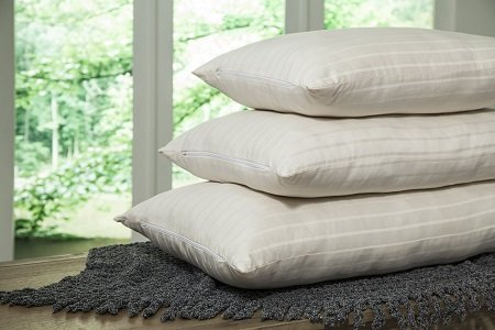 Three vegan wool pillows stacked