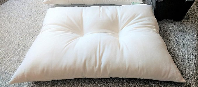 A white Kapok Pillow for sleeping - great for neck contouring.