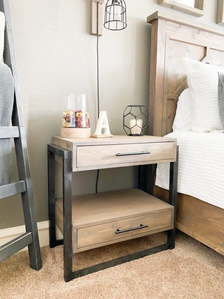 A modern clean lines black frame nightstand with drawers