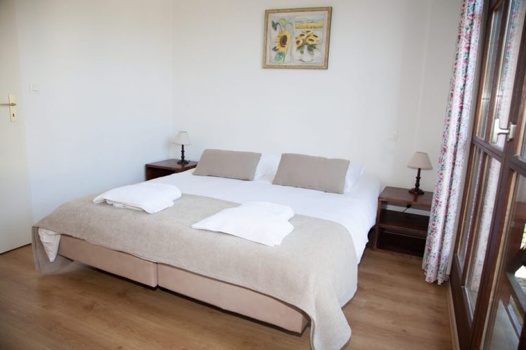 Two twin mattresses joined to form a king sized bed in a new and bright bedroom