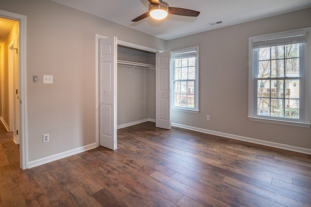 Unfurnished bedroom with beige walls and a closet