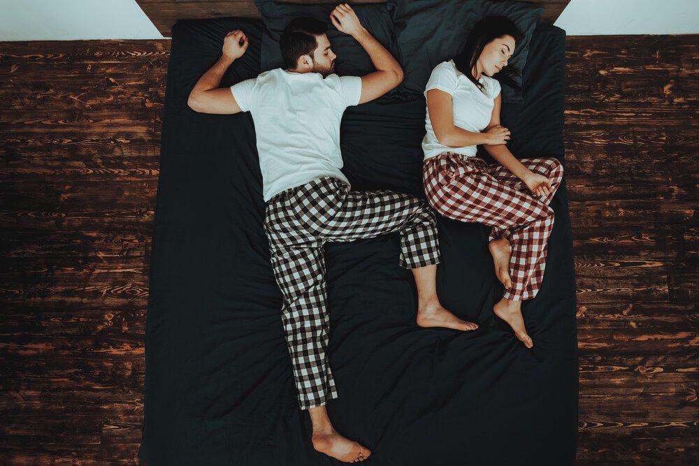 Couple sleeping, one stomach sleeper, one side sleeper
