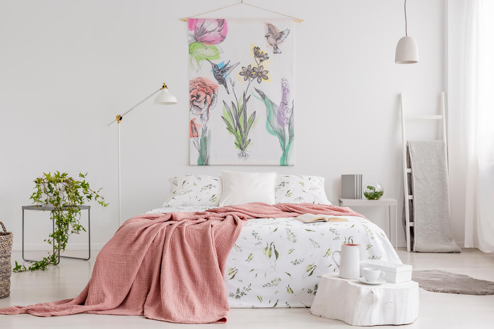 Bright, peach and white bedroom, green plants, animal themed bedding.