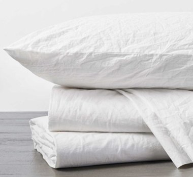 A beautiful sheets and pillowcase set of crinkled percale sheets in color alpine white