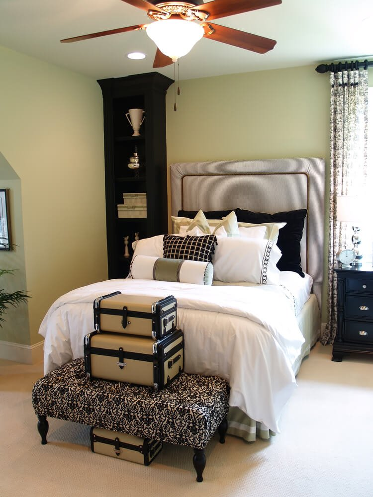 Classic Design bedroom featuring single bed for guests, pillow arrangement and classy furniture