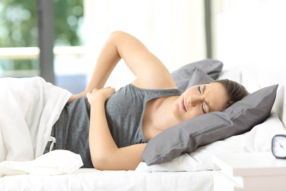 Woman experience pain in lower hip and back due to fibromyalgia