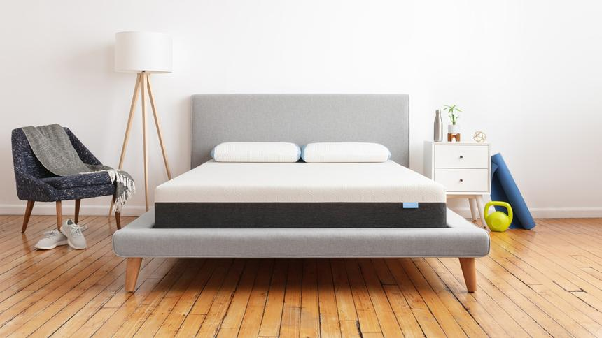 The best selling Bear Original Mattress in a modern bedroom with wooden flooring and white walls.