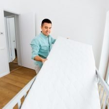 A male parent turning over a crib mattress - a great tip for make it last for longer!