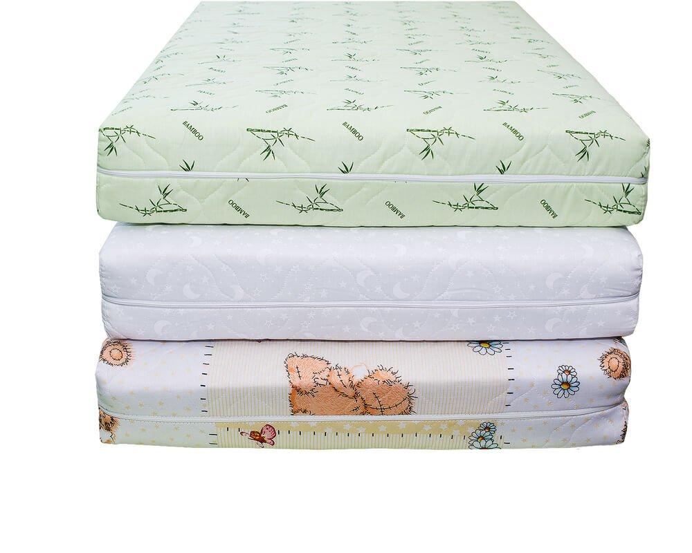 Baby crib mattresses stacked up