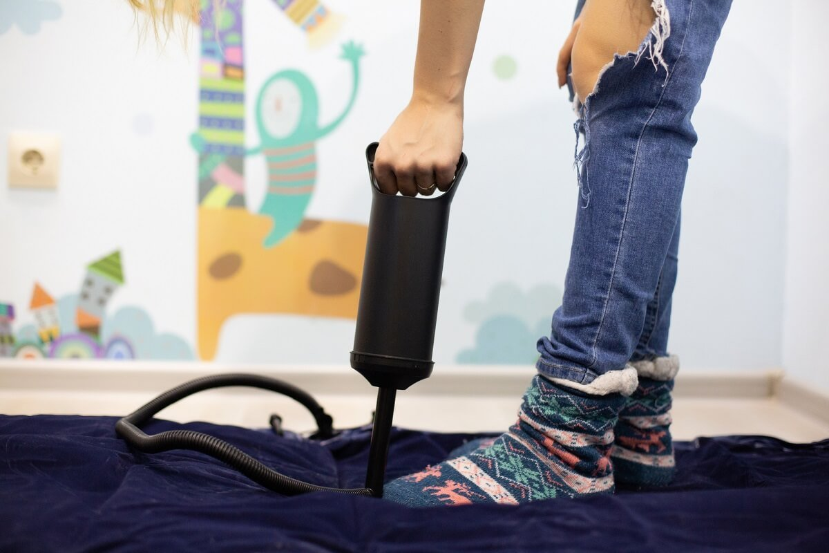 Pumping an air bed with a pump