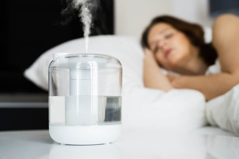 Home Air Humidifier Device In Bedroom Near Woman Sleeping