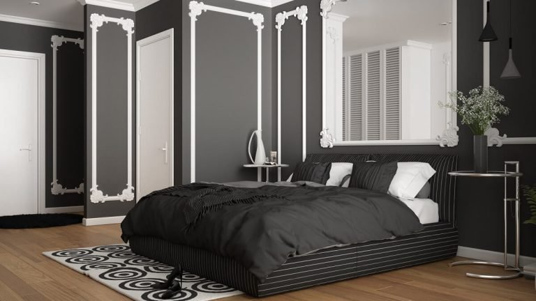 Modern white and gray bedroom in classic room with wall moldings, parquet, double bed with duvet and pillows, minimalist bedside tables, mirror and decors. Interior design concept