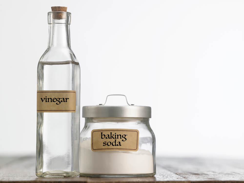 White vinegar and baking soda cleaning essentials for white bedding and getting rid of smells and bacteria