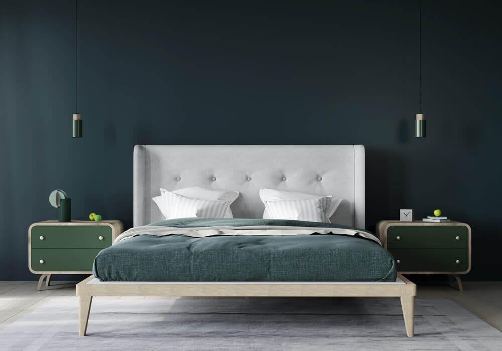 Stylish bedroom interior in dark green walls and light grey