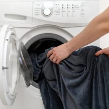 Doing laundry (blankets) in washing machine