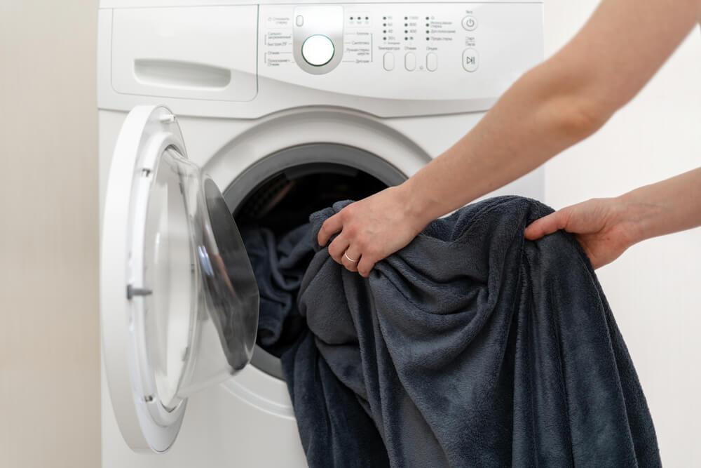 Doing laundry (blankets) in washing machine