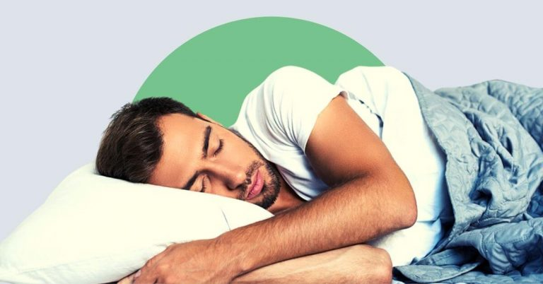 A young man sleeping on a plush supportive pillow