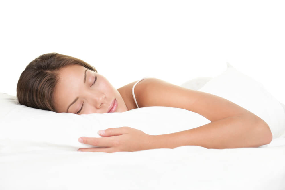 Woman sleeping on her side on a supportive eco friendly pillow